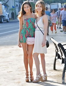 Softcore shoot of two sexy babes in general public
