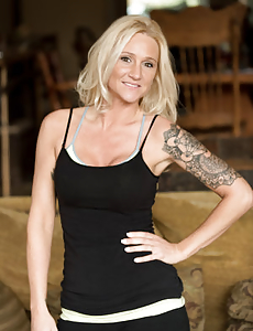 Blonde milf shows off a lot more than the woman tattoo